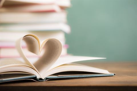 Love Reading! Heart shape in open book pages.jpg